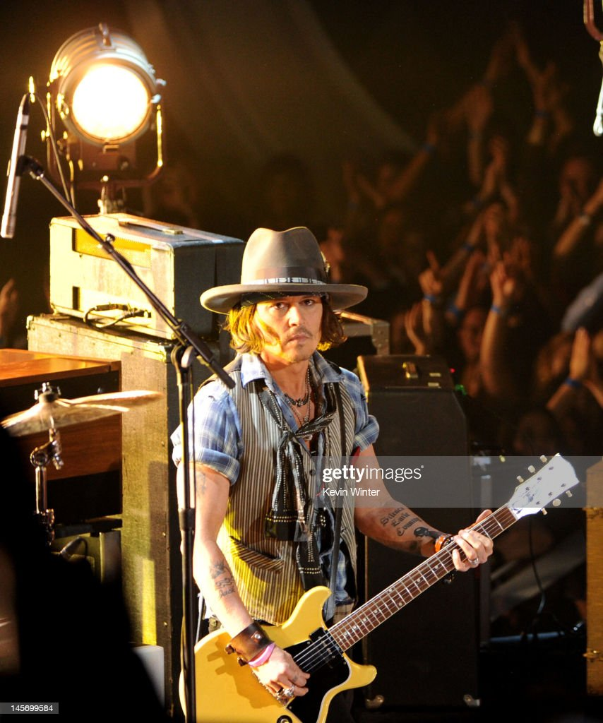 Musician/actor Johnny Depp performs onstage during the 2012 MTV Movie Awards held at Gibson Amphitheatre on June 3, 2012 in Universal City, California.