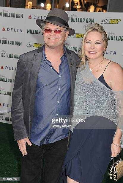 Musician/actor Micky Dolenz and Donna Quinter arrive at the Los Angeles premiere of 'Million Dollar Arm' at the El Capitan Theatre on May 6 2014 in...
