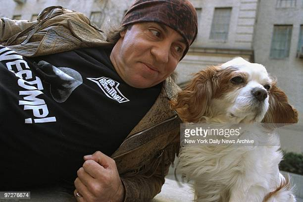 Musicianactor Steve Van Zandt and his dog Jake take a breather while strolling along W 57th St