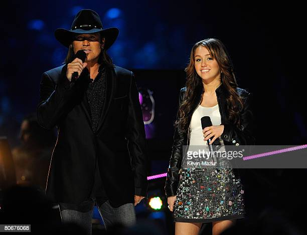 Musician/actors Billy Ray Cyrus and Miley Cyrus speak onstage during the 2008 CMT Music Awards at the Curb Event Center at Belmont University on...