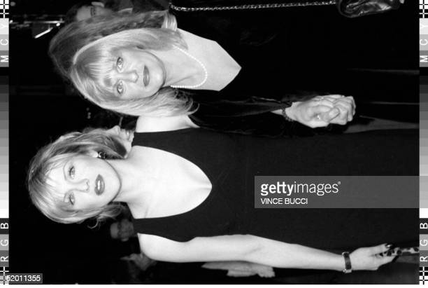 Musicianactress Courtney Love arrives with her motherinlaw Wendy Cobain the mother of rock musician Kurt Cobain who committed suicide in 1994 at the...