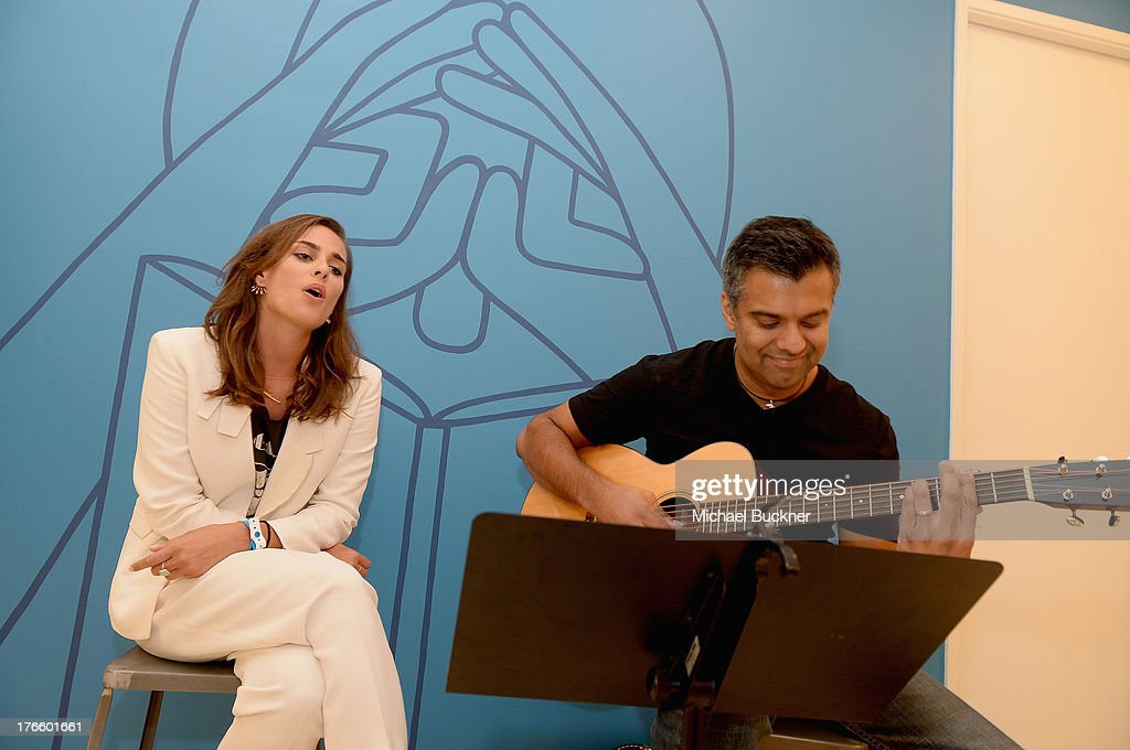 Musician/actress Sophie Auster (L) performs at Warby Parker's store opening in The Standard, Hollywood on August 15, 2013 in Los Angeles, California.