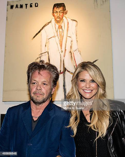 Musician/artist John Mellencamp and model/actress Christie Brinkley attend Mr Mellencamp's art exhibition opening The Isolation Of Mister at the ACA...