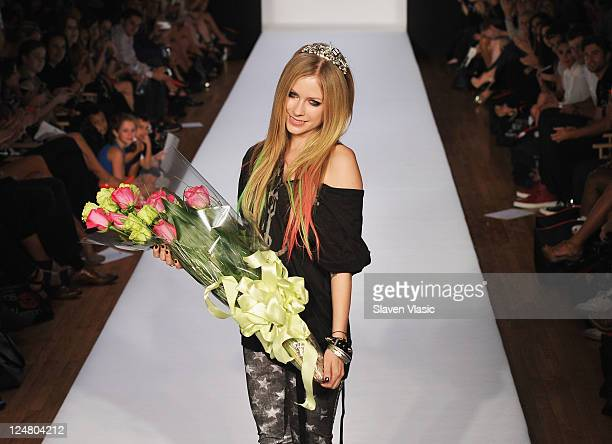 Musician/designer Avril Lavigne walks the runway at the Abbey Dawn by Avril Lavigne Spring 2012 fashion show during Style360 on September 12 2011 in...