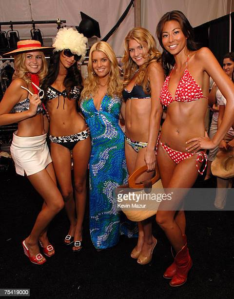 Musician/Designer Jessica Simpson and Models backstage before her Swimwear Show at the Raleigh Hotel on July 14, 2007 in Miami Beach, Florida.