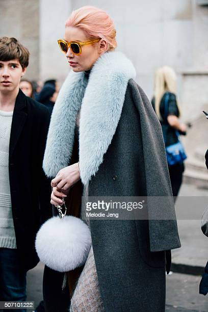 Musician/Model Iggy Azalea attends the Viktor Rolf Couture show at Palais de Tokyo with pink and blonde hair in a french braid a gray coat with a...