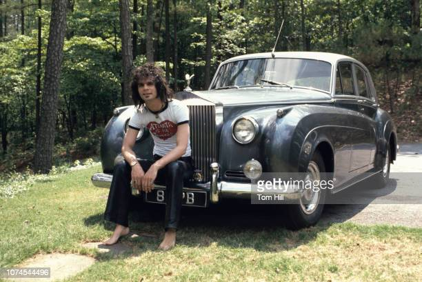 Musicianproducer Al Kooper relaxes with his RollsRoyce at his home on May 25 1973 in Atlanta Georgia