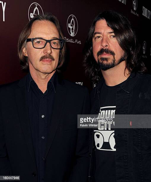 Musician/producer Butch Vig and director/musicisn Dave Grohl arrive at the premiere of Sound City at ArcLight Cinemas Cinerama Dome on January 31...