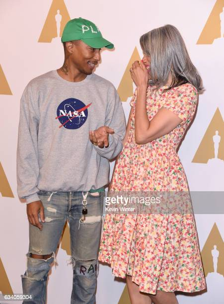 Musician/producer Pharrell Williams and Mimi Valdes attend the 89th Annual Academy Awards Nominee Luncheon at The Beverly Hilton Hotel on February 6...