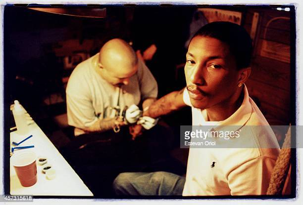 Musician/Producer Pharrell Williams gets inked by Mister Cartoon Downtown Los Angeles 1998