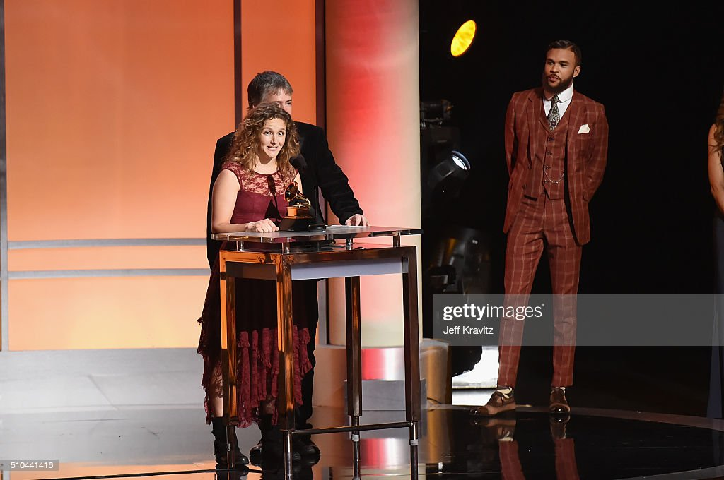 Musicians Abigail Washburn (L) and Bela Fleck accept the award for Best Folk Ablum for 'Bela Fleck and Abigail Washburn' alongside singer/producer Jidenna (R) onstage during The 58th GRAMMY Premiere Ceremony at Los Angeles Convention Center on February 15, 2016 in Los Angeles, California.
