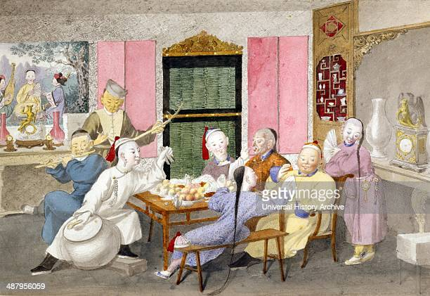 Musicians accompany two men eating attended by three servants Published between 1860 and 1900 Drawing shows two older gentlemen seated at the head of...