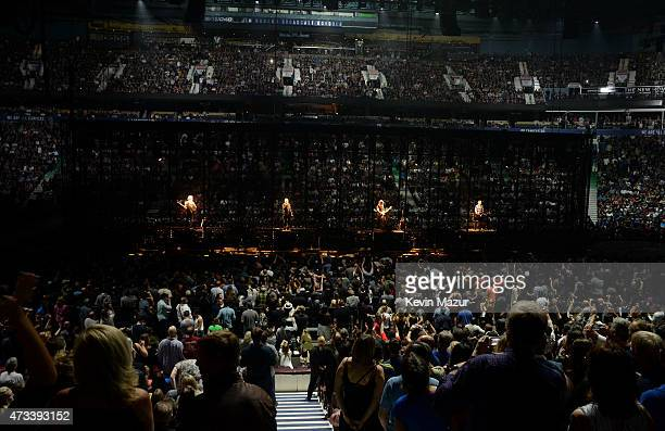 Musicians Adam Clayton Bono The Edge and Larry Mullen Jr of U2 perform onstage during the U2 iNNOCENCE eXPERIENCE tour opener in Vancouver at Rogers...