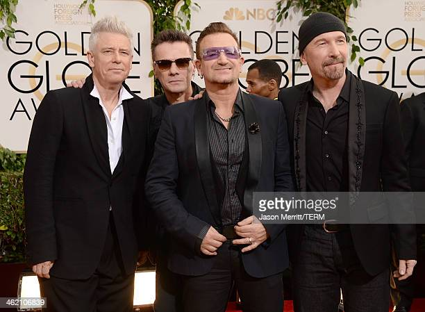Musicians Adam Clayton Larry Mullen Jr Bono and The Edge of U2 attend the 71st Annual Golden Globe Awards held at The Beverly Hilton Hotel on January...
