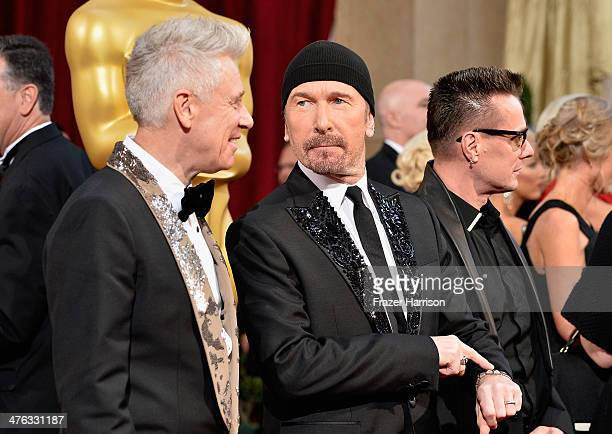Musicians Adam Clayton The Edge and Larry Mullen Jr of U2 attend the Oscars held at Hollywood Highland Center on March 2 2014 in Hollywood California