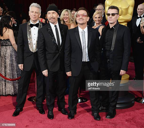 Musicians Adam Clayton The Edge Bono and Larry Mullen Jr attend the Oscars held at Hollywood Highland Center on March 2 2014 in Hollywood California