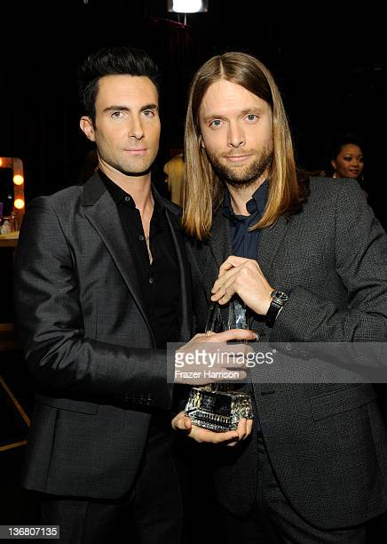 Musicians Adam Levine and James Valentine of Maroon 5 with the award for Favorite Band attend the 2012 People's Choice Awards at Nokia Theatre LA...