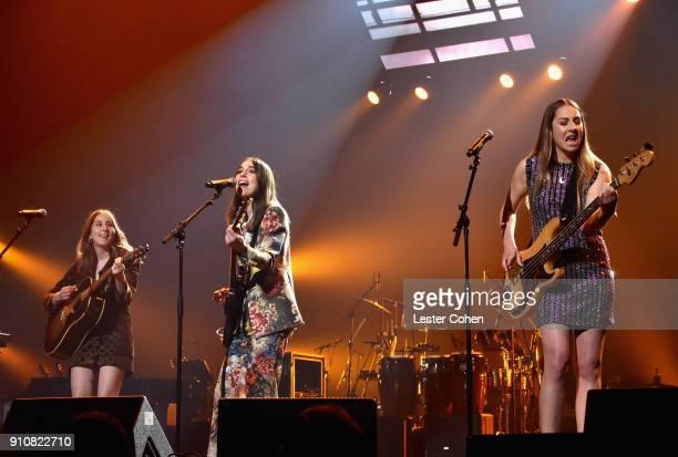 Musicians Alana Haim Danielle Haim and Este Haim of Haim perform onstage at MusiCares Person of the Year honoring Fleetwood Mac at Radio City Music...