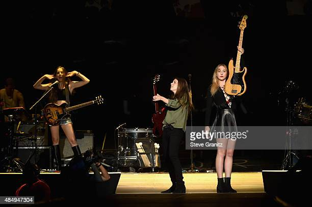 Musicians Alana Haim Danielle Haim and Este Haim of the band HAIM perform onstage during Taylor Swift The 1989 World Tour Live In Los Angeles at...