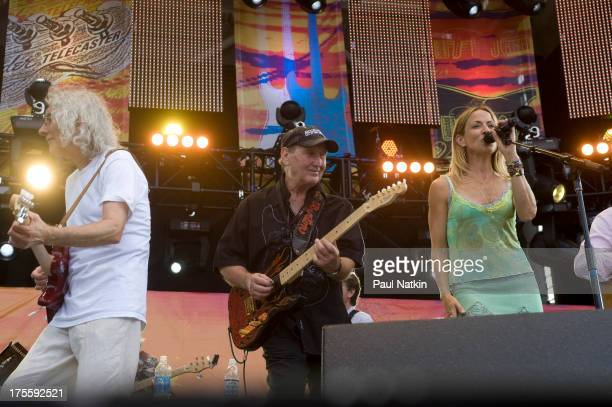 Musicians Albert Lee, James Burton and Sheryl Crow at Eric Clapton's Crossroads Guitar Festival at Toyota Park, Bridgeview, Illinois, June 26, 2010.