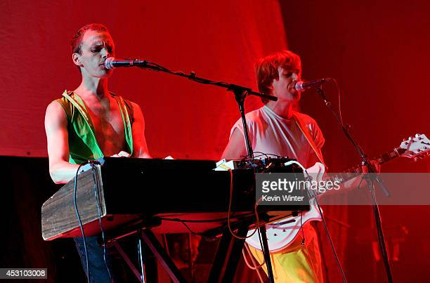 Musicians Alden Penner and Nick Thorburn of The Unicorns perform during The Reflector Tour at The Forum on August 2 2014 in Inglewood California