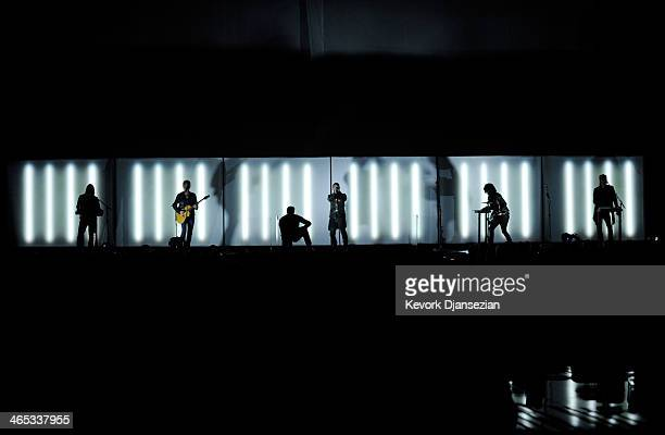 Musicians Alessandro Cortini Lindsey Buckingham Trent Reznor Ilan Rubin and Robin Fink of Nine Inch Nails perform onstage during the 56th GRAMMY...