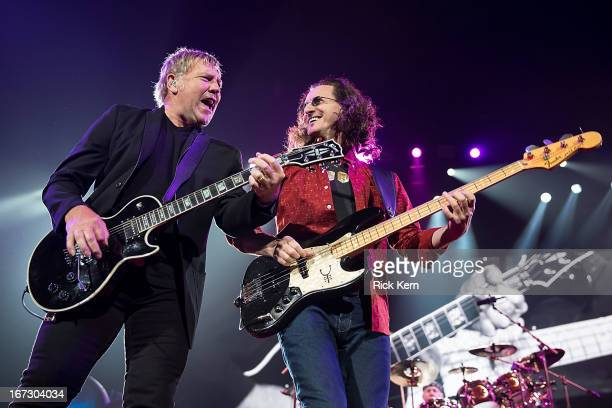 Musicians Alex Lifeson and Geddy Lee of Rush perform in concert at The Frank Erwin Center on April 23 2013 in Austin Texas