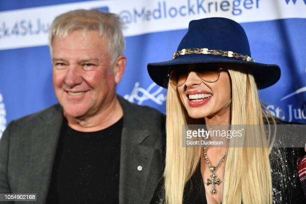 Musicians Alex Lifeson of the band Rush and Orianthi attend the Medlock Krieger All Star Concert benefiting St Judes Childrens Hospital at Saddle...