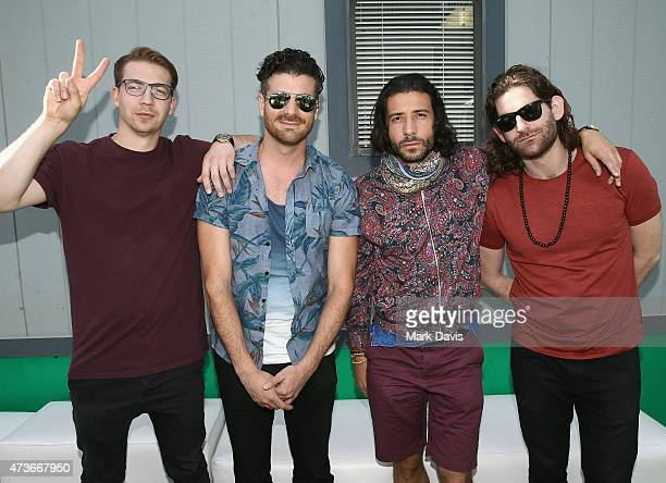 Musicians Alex Tanas Mark Pellizzer Nasri Atweh and Ben Spivak of Magic pose backstage during Rock in Rio USA at the MGM Resorts Festival Grounds on...