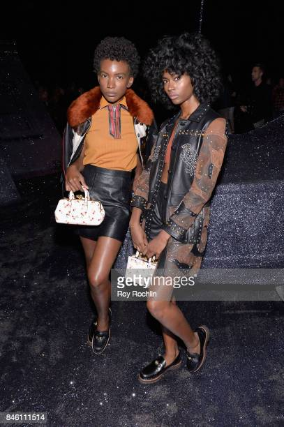 Musicians Alexe Belle and Isis Valentino of St Beauty attend Coach Spring 2018 Fashion Show during New York Fashion Week at Basketball City Pier 36...