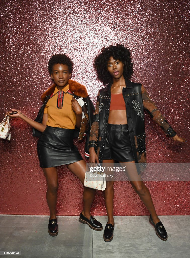 Musicians Alexe Belle (L) and Isis Valentino of St. Beauty pose for a portrait during Coach Spring 2018 Fashion Show during New York Fashion Week at Basketball City - Pier 36 - South Street on September 12, 2017 in New York City.