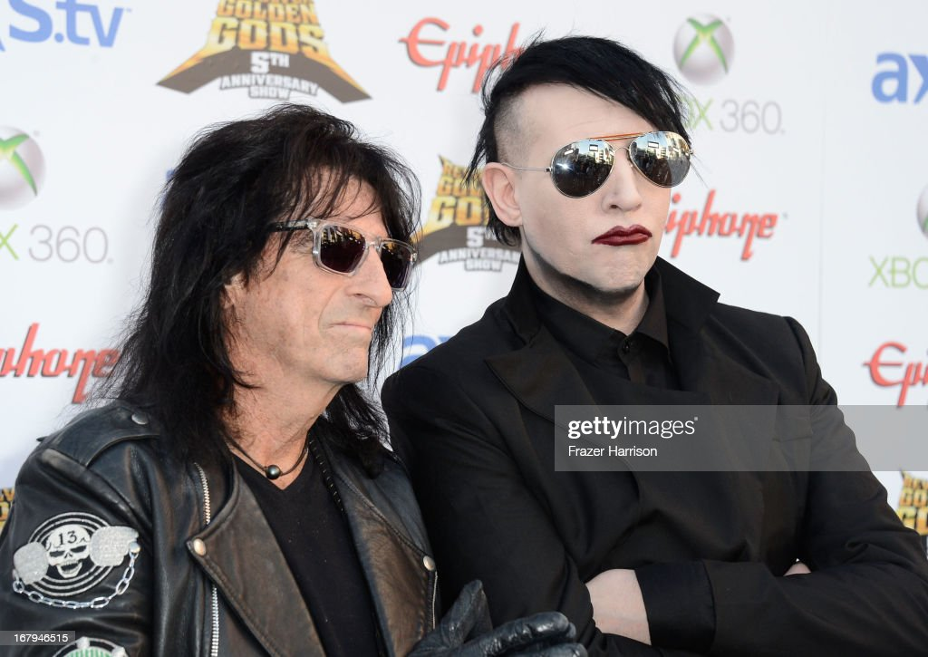 Musicians Alice Cooper and Marilyn Manson arrive at the 5th Annual Revolver Golden Gods Award Show at Club Nokia on May 2, 2013 in Los Angeles, California.