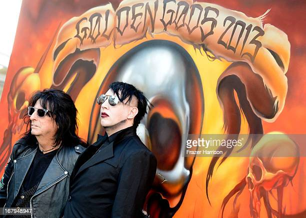 Musicians Alice Cooper and Marilyn Manson arrive at the 5th Annual Revolver Golden Gods Award Show at Club Nokia on May 2 2013 in Los Angeles...
