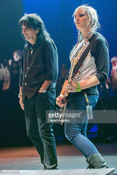 Musicians Alice Cooper and Nita Strauss perform on stage during sound check for Alice Cooper's Christmas Pudding charity concert at Comerica Theatre...