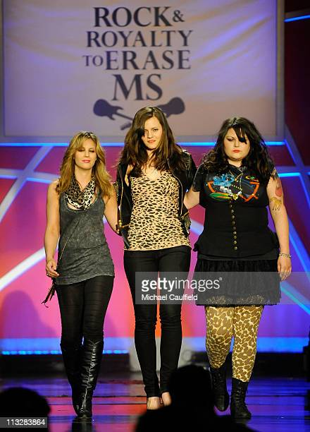 Musicians Allison Robertson Brett Anderson and Maya Ford of the band The Donnas walk the runway at the 18th Annual Race to Erase MS event cochaired...