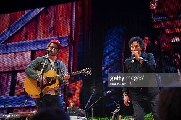 Musicians Amos Lee and Mickey Raphael performs onstage during the Farm Aid benefit concert at the Saratoga Performing Arts Center, Saratoga Springs,...