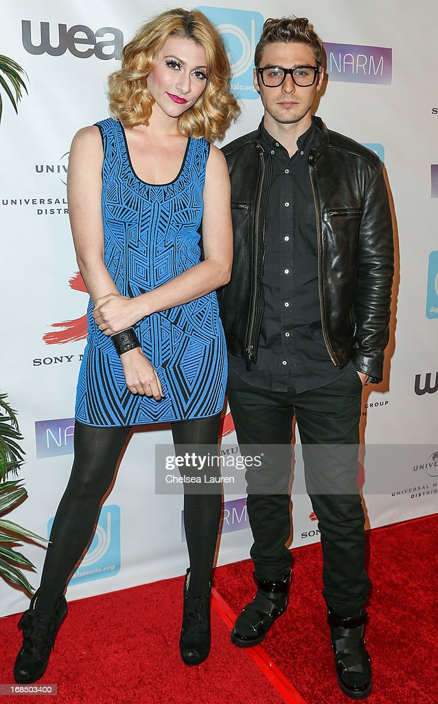 Musicians Amy Heidemann (L) and Nick Louis Noonan of Karmen arrive at the NARM Music Biz Awards dinner party at the Hyatt Regency Century Plaza on May 9, 2013 in Century City, California.