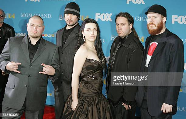 Musicians Amy Lee Ben Moody John LeCompt and Rocky Gray of Evanescence arrive at the 2004 Billboard Music Awards on December 8 2004 at the MGM Grand...