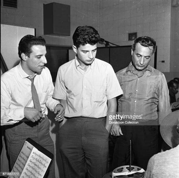 Musicians and producers Barry Mann Gerry Goffin and Al Nevins at a Barry Mann recording session at RCA on September 1 1961 in New York