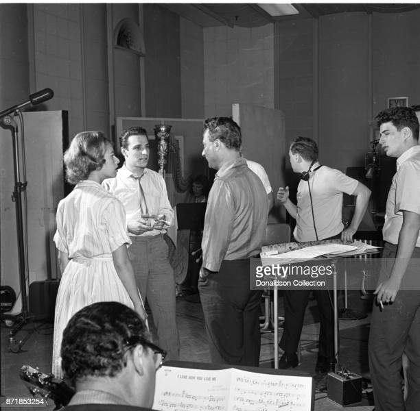 Musicians and producers Carole King Barry Mann Al Nevins and Gerry Goffin at a Barry Mann recording session at RCA on September 1 1961 in New York