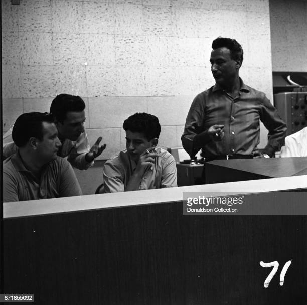 Musicians and producers Don Kirshner Barry Mann Gerry Goffin and Al Nevins at a Barry Mann recording session at RCA on September 1 1961 in New York