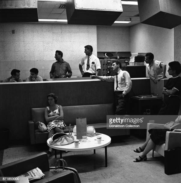 Musicians and producers Don Kirshner Gerry Godffin Al Nevins at a Barry Mann recording session at RCA on September 1 1961 in New York