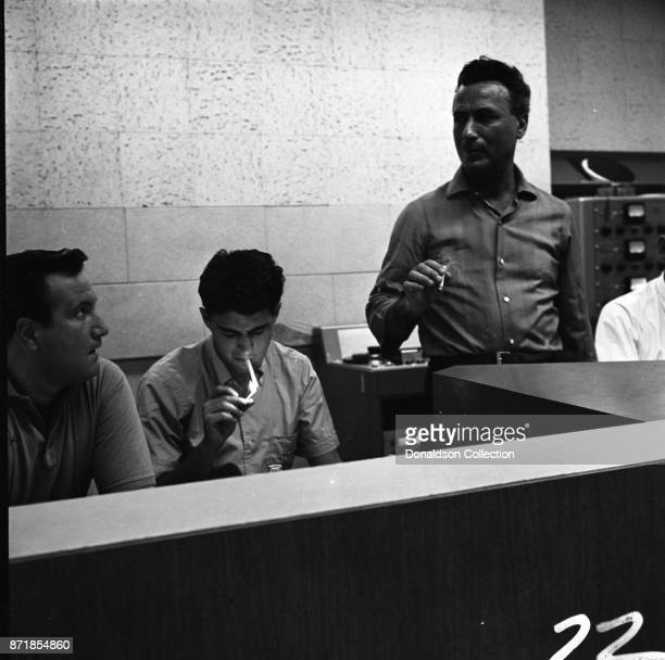 Musicians and producers Don Kirshner Gerry Goffin and Al Nevins at a Barry Mann recording session at RCA on September 1 1961 in New York