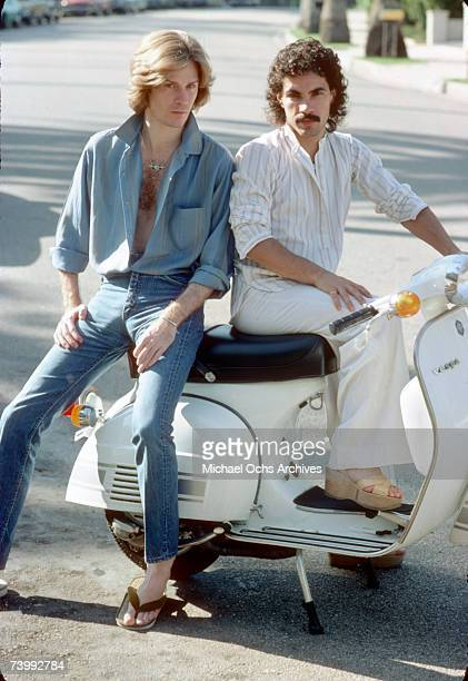 Musicians and singers Daryl Hall and John Oates of the rock duo Hall Oates pose for a portrait on a Vespa scooter in June 1976 in Los Angeles...