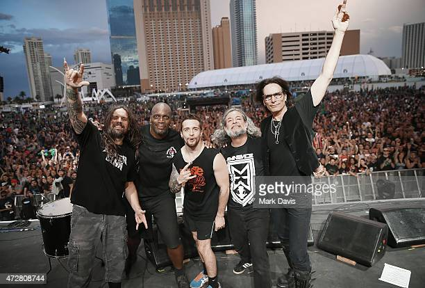Musicians Andreas Kisser Derrick Green Eloy Casagrande and Paulo Xisto Pinto Jr of Sepultura with Steve Vai pose onstage during Rock in Rio USA at...