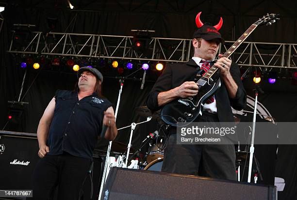 Musicians Andy Bowman and Evan Christopher of Hells Bells perform during the 2012 Rock On The Range festival at Crew Stadium on May 18 2012 in...