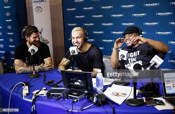 Musicians Andy Hurley and Pete Wentz of Fall Out Boy and radio host Sway Calloway attend SiriusXM at Super Bowl XLIX Radio Row at the Phoenix...