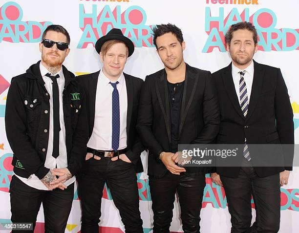 Musicians Andy Hurley Patrick Stump Peter Wentz and Joe Trohman of Fall Out Boy arrive at the 2013 TeenNick HALO Awards at Hollywood Palladium on...