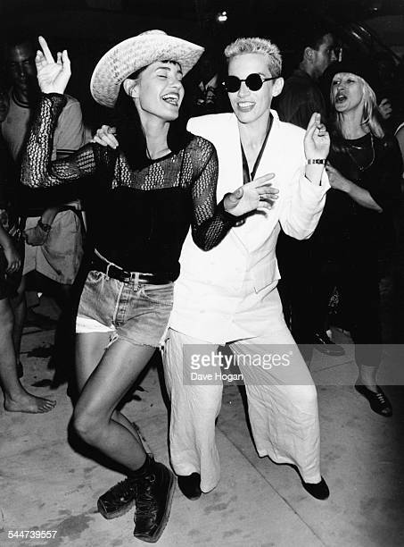 Musicians Annie Lennox and Siobhan Fahey dancing after a 'Eurythmics' warm up gig London August 24th 1989
