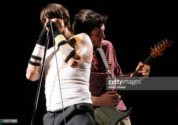 """Musicians Anthony Kiedis and John Frusciante from the band """"Red Hot Chili Peppers"""" performs during day 2 of the Coachella Music Festival held at the..."""